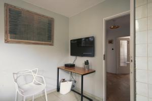 Telewizja i/lub zestaw kina domowego w obiekcie Opera Art Apartment