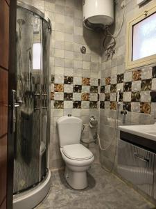 Um banheiro em Seven Gardens Pro