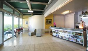 The lobby or reception area at ALA Hotel