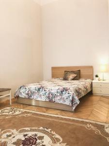 Кровать или кровати в номере Apartment Rubisteina 3