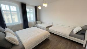 Postel nebo postele na pokoji v ubytování R&J apartmány