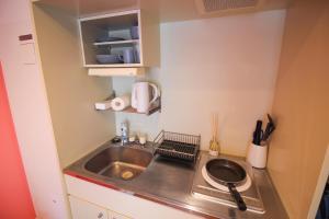 A kitchen or kitchenette at Sunplaza 126 Shimanouchi - Vacation STAY 42941v