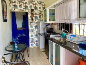 A kitchen or kitchenette at Higuey Center City