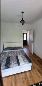 Ein Bett oder Betten in einem Zimmer der Unterkunft Riverview Buna-Mostar