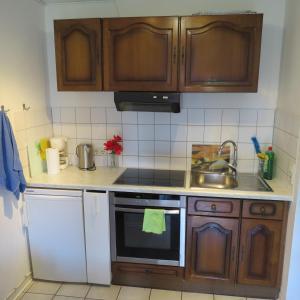 Küche/Küchenzeile in der Unterkunft Café de Paris