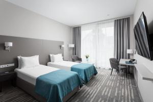 Кровать или кровати в номере Sport inn hotel & wellness