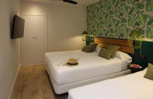 Letto o letti in una camera di Chic & Basic Lemon Boutique Hotel