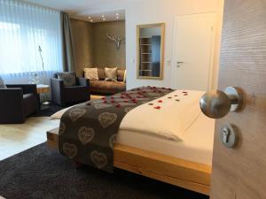 Ein Bett oder Betten in einem Zimmer der Unterkunft NaturBoutique Hotel RAUSZEIT