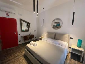 A bed or beds in a room at Holiday Guesthouse