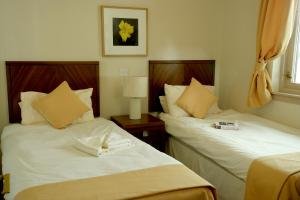 A bed or beds in a room at Macdonald Spey Valley Resort