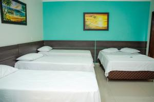 Cama ou camas em um quarto em Hotel Della Vita