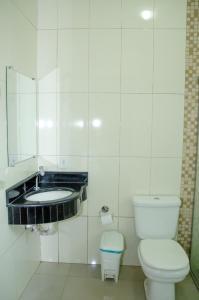 Um banheiro em Hotel Della Vita