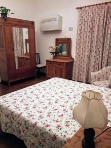 A bed or beds in a room at Il Campanile B&B