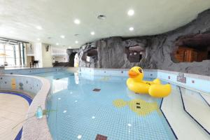 The swimming pool at or near Ramada Plaza by Wyndham Jeju Ocean Front