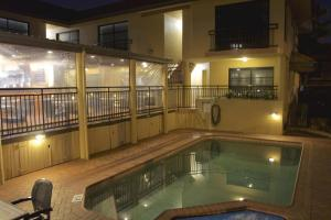 The swimming pool at or near Pegasus Motor Inn and Serviced Apartments