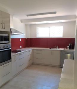 A kitchen or kitchenette at Sandcastles on the Beach Bargara