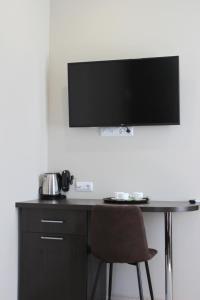 Телевизор и/или развлекательный центр в Rosemary Inn