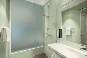 A bathroom at Super 8 by Wyndham Munich City North