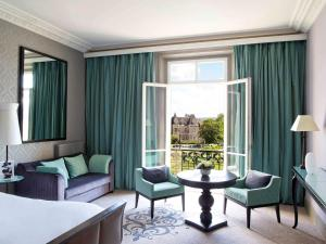 A seating area at Le Grand Hotel de Cabourg - MGallery Hotel Collection