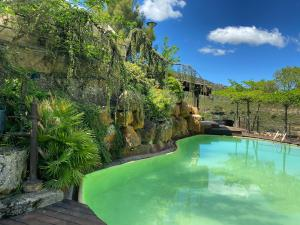 The swimming pool at or near Hotel Rural Castillo de Somaén