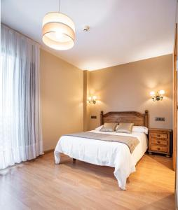 Un ou plusieurs lits dans un hébergement de l'établissement Hotel Santa Cruz