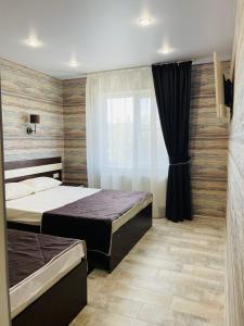 Кровать или кровати в номере Гостевой дом Никлена