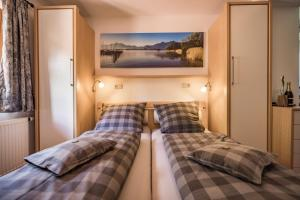 Ein Bett oder Betten in einem Zimmer der Unterkunft Pension Gimpl