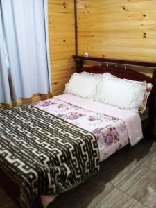 A bed or beds in a room at Sitio Itaimbe Morro da Igreja