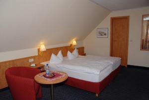 Ein Bett oder Betten in einem Zimmer der Unterkunft Hotel Alte Schule
