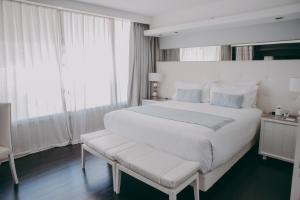 A bed or beds in a room at 1828 Smart Hotel Boutique