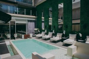 The swimming pool at or close to 1828 Smart Hotel Boutique