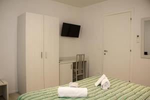 Un ou plusieurs lits dans un hébergement de l'établissement Hotel Sant'Orsola City House