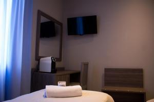 Télévision ou salle de divertissement dans l'établissement Hotel Sant'Orsola City House