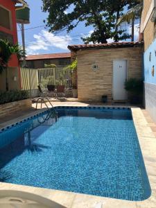 A piscina localizada em Pousada Cantinho do Porto ou nos arredores