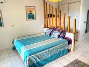 Cama ou camas em um quarto em Grand Studio Les Horizons Papeete
