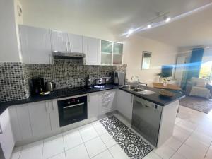 A cozinha ou cozinha compacta de Grand Studio Les Horizons Papeete