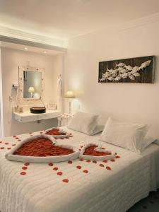 A bed or beds in a room at Hotel Pousada 7 Mares