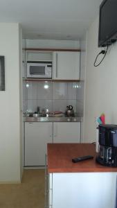 Cuisine ou kitchenette dans l'établissement Hotel Rasch
