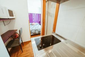 A kitchen or kitchenette at Hospederia Rincon De Leon