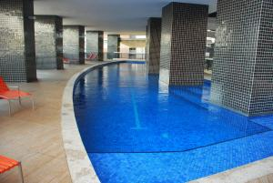 The swimming pool at or close to Landscape by Iracema Imoveis