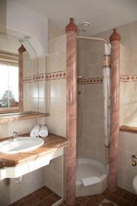 Ein Badezimmer in der Unterkunft Haus Feichtner