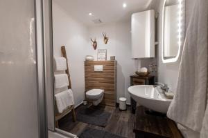 Ein Badezimmer in der Unterkunft SportRedia Appartements