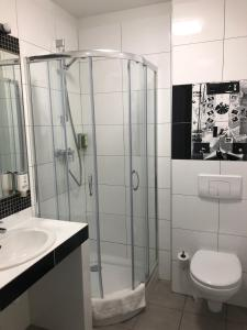 Łazienka w obiekcie Dom Młynarza