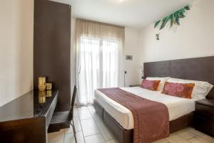 Letto o letti in una camera di Residenza D-Place Ponchielli