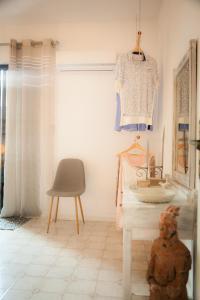 Coin salon dans l'établissement Rhodes Backpackers Boutique Hostel and Apartments
