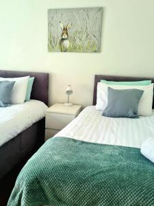 A bed or beds in a room at Churchview