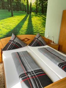 Ein Bett oder Betten in einem Zimmer der Unterkunft Apartments & Ferienhaus Senftner