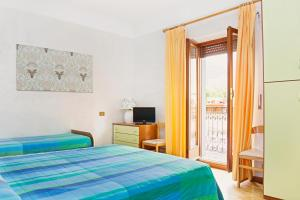 A bed or beds in a room at Albergo Centrale Scanno