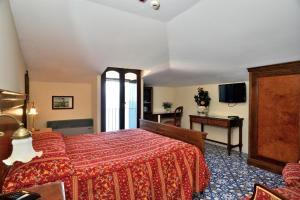 Letto o letti in una camera di Hotel La Tonnarella