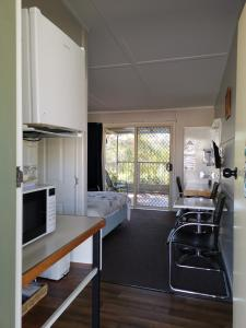 A kitchen or kitchenette at Donald Riverside Motel